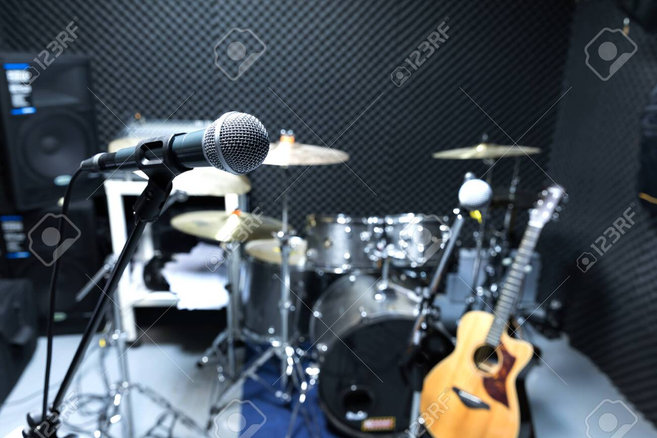 Professional condenser studio microphone, Musical Concept. recording, selective focus microphone in radio studio, selective focus microphone and blur musical equipment guitar ,bass, drum piano background. - 146231736