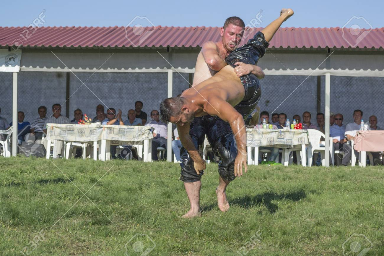 HILIA EVROS, GREECE - AUGUST 18:Unidentified wrestlers in the Annual Oil Wrestling Event in HILIA-EVROS on August 18, 2013 in Hilia Evros, Greece Stock Photo - 22266004