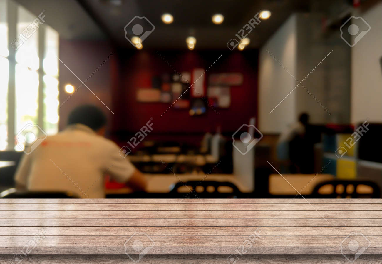 Empty wooden table top with lights bokeh on blur restaurant background. - 156999451