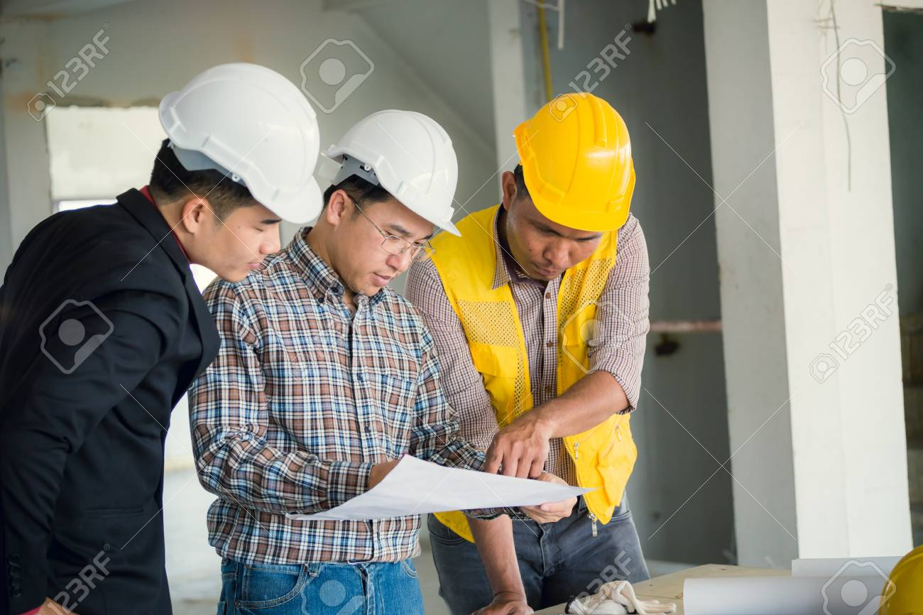 Management consulting and engineers and foreman working with stock management consulting and engineers and foreman working with blueprint and drawing on work table for management malvernweather Choice Image