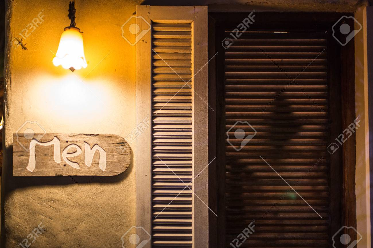 Public Men Toilet Sign On Old Wooden With Light At Night Time. Stock ...