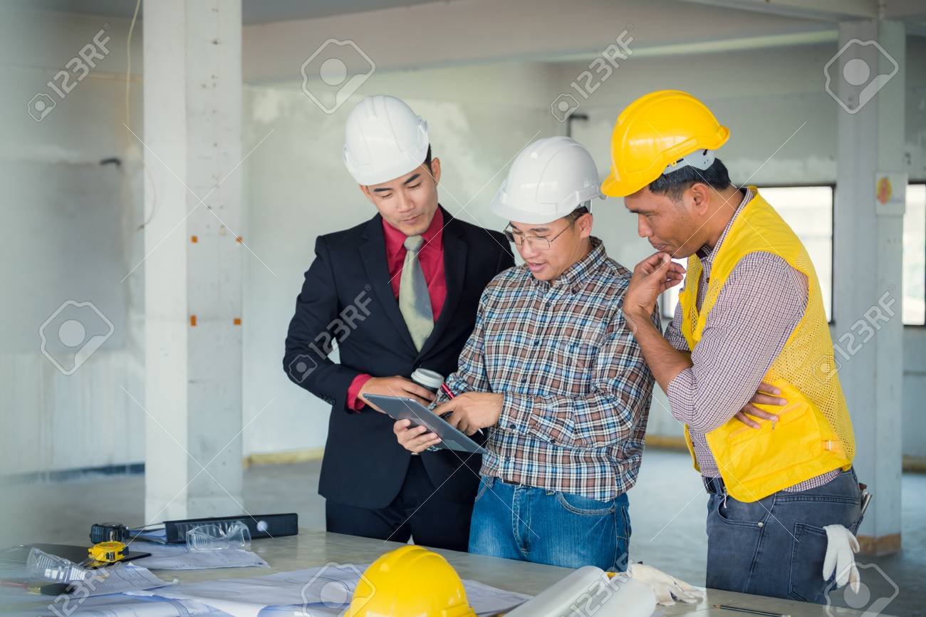 Management consulting and engineers and foreman working with stock management consulting and engineers and foreman working with blueprint and drawing on work table for management malvernweather Gallery