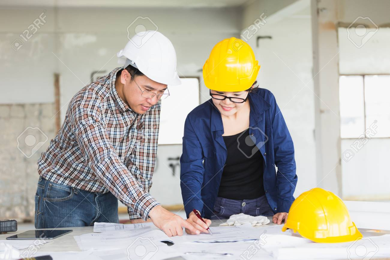 Management consulting or engineer and labor woman working with management consulting or engineer and labor woman working with blueprint and drawing on work table in malvernweather Gallery