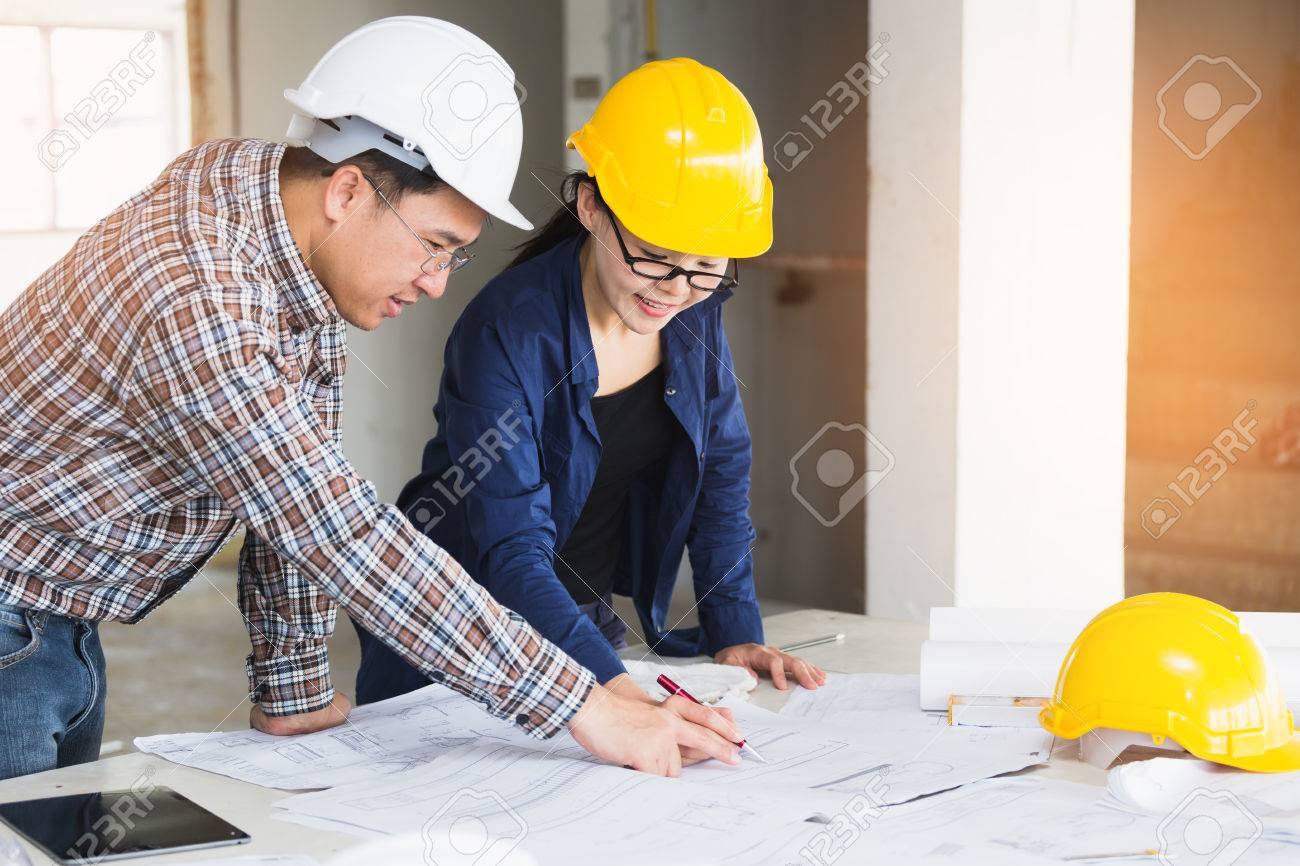 Management consulting or engineer and labor woman working with management consulting or engineer and labor woman working with blueprint and drawing on work table in malvernweather Choice Image