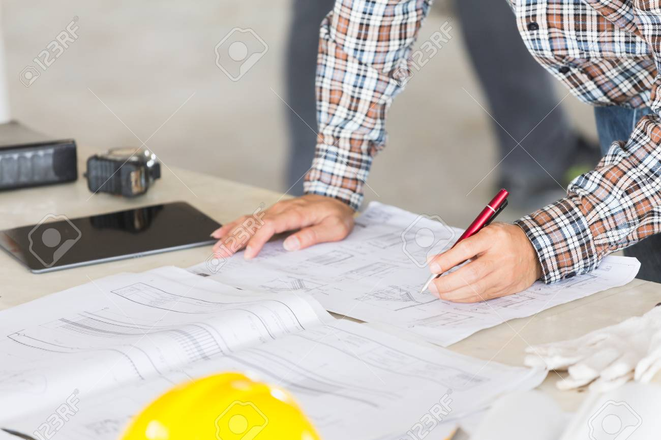 Management consulting with engineers working with blueprint and management consulting with engineers working with blueprint and drawing on work table in for management business malvernweather Choice Image