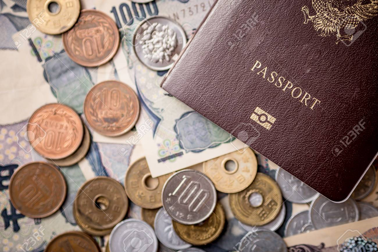 Japanese Yen Banknotes and Japanese Yen coin with passport shot stack layers on floor. japanese currency. financial money and travel concept. - 101542614