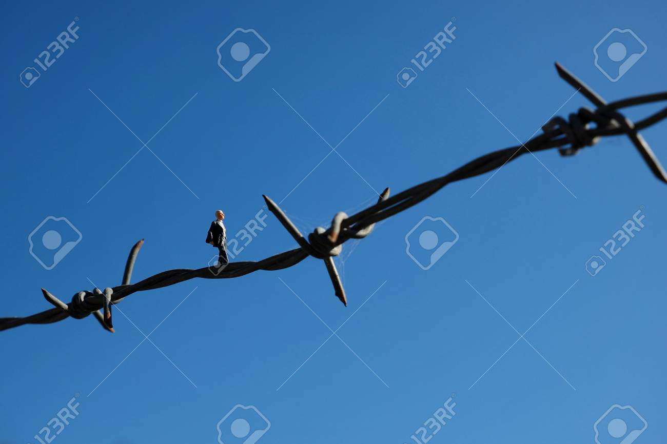 Miniature People : Business Man Walking On The Barbed Wire Stock ...