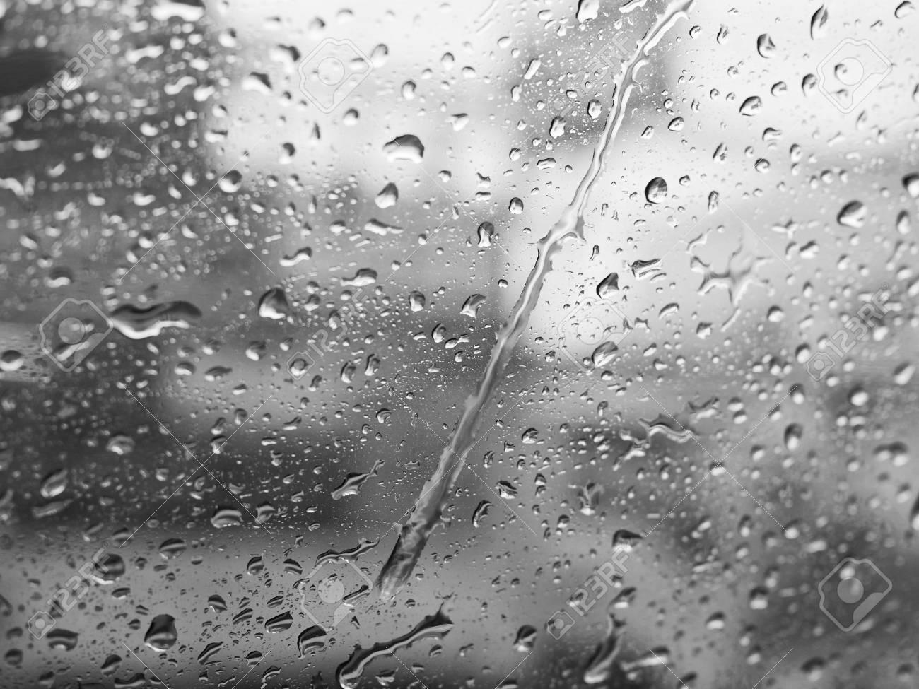 Rain on window black and white