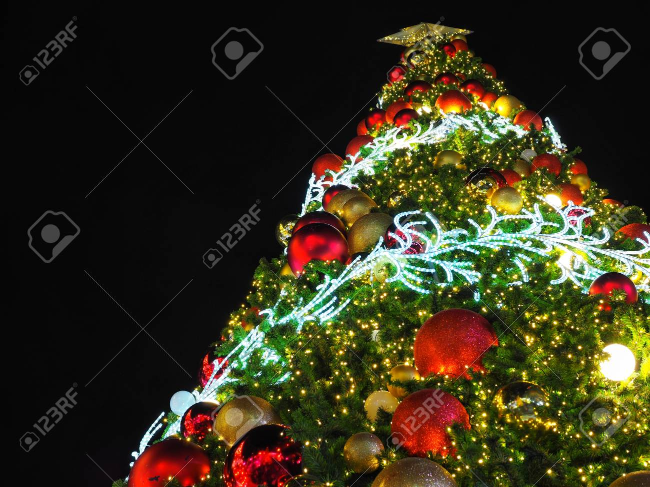 Big Christmas Tree Lighting From Low Angle View At Night In ...