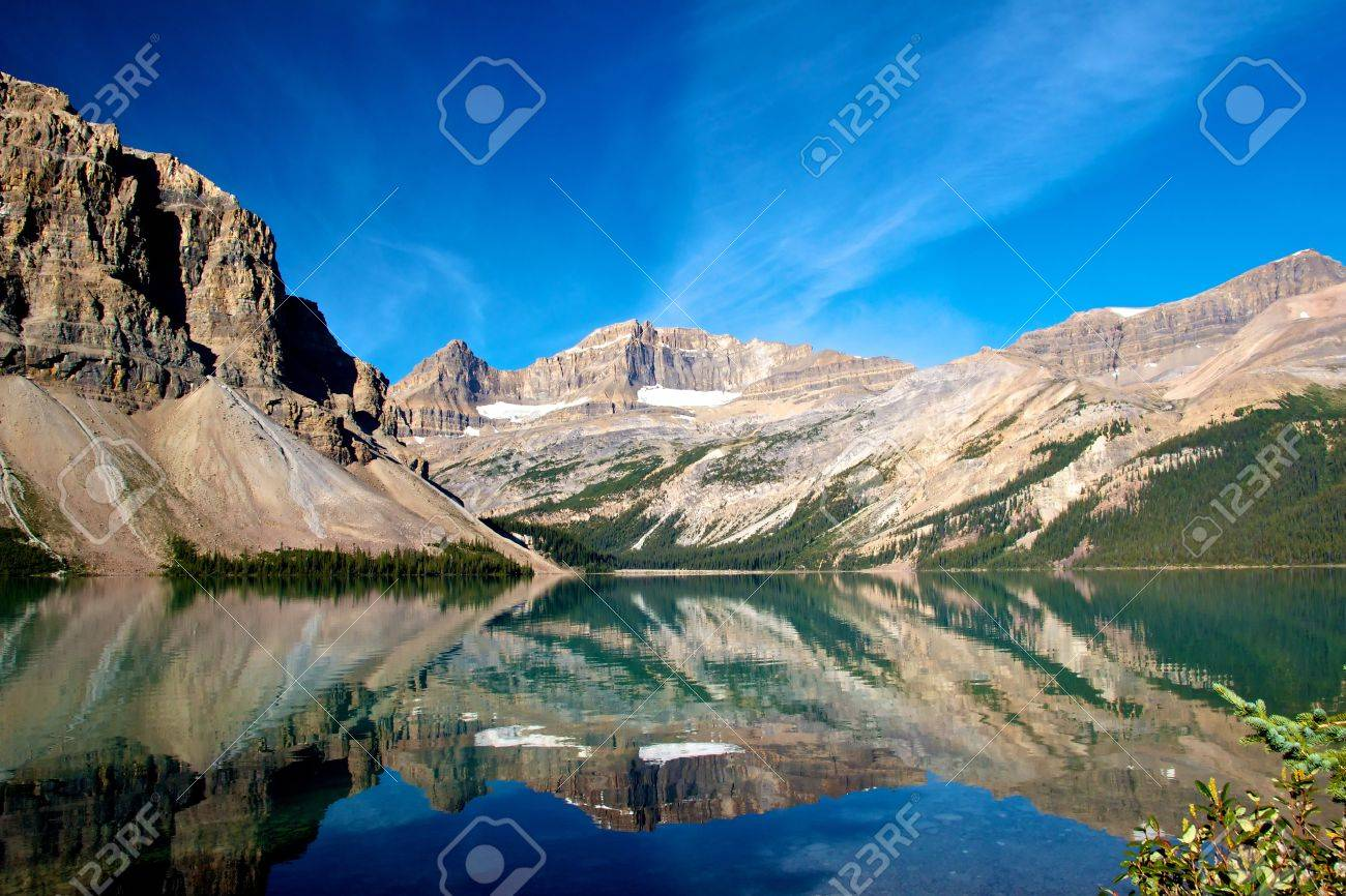 Quiet scenery of Bow Lake with the Rocky Mountains reflecting - 15320759