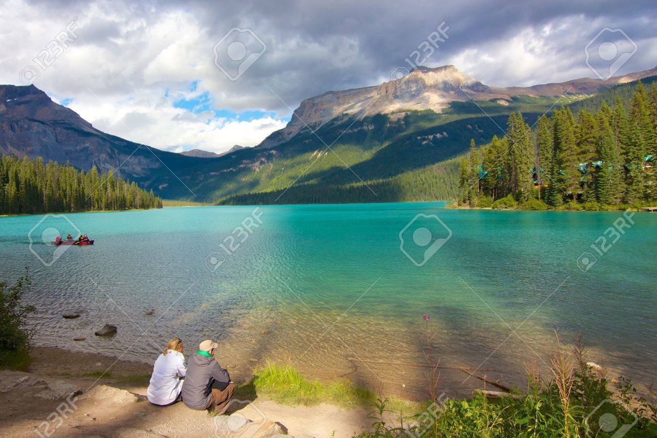 Couple looking out on beautiful Emerald Lake at dusk - 16270250