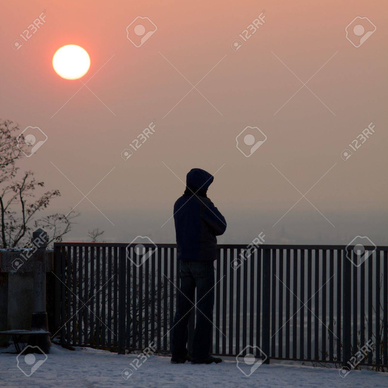 Lonely Guy Standing Below A Clear Sunset, Watching The Scenery ...
