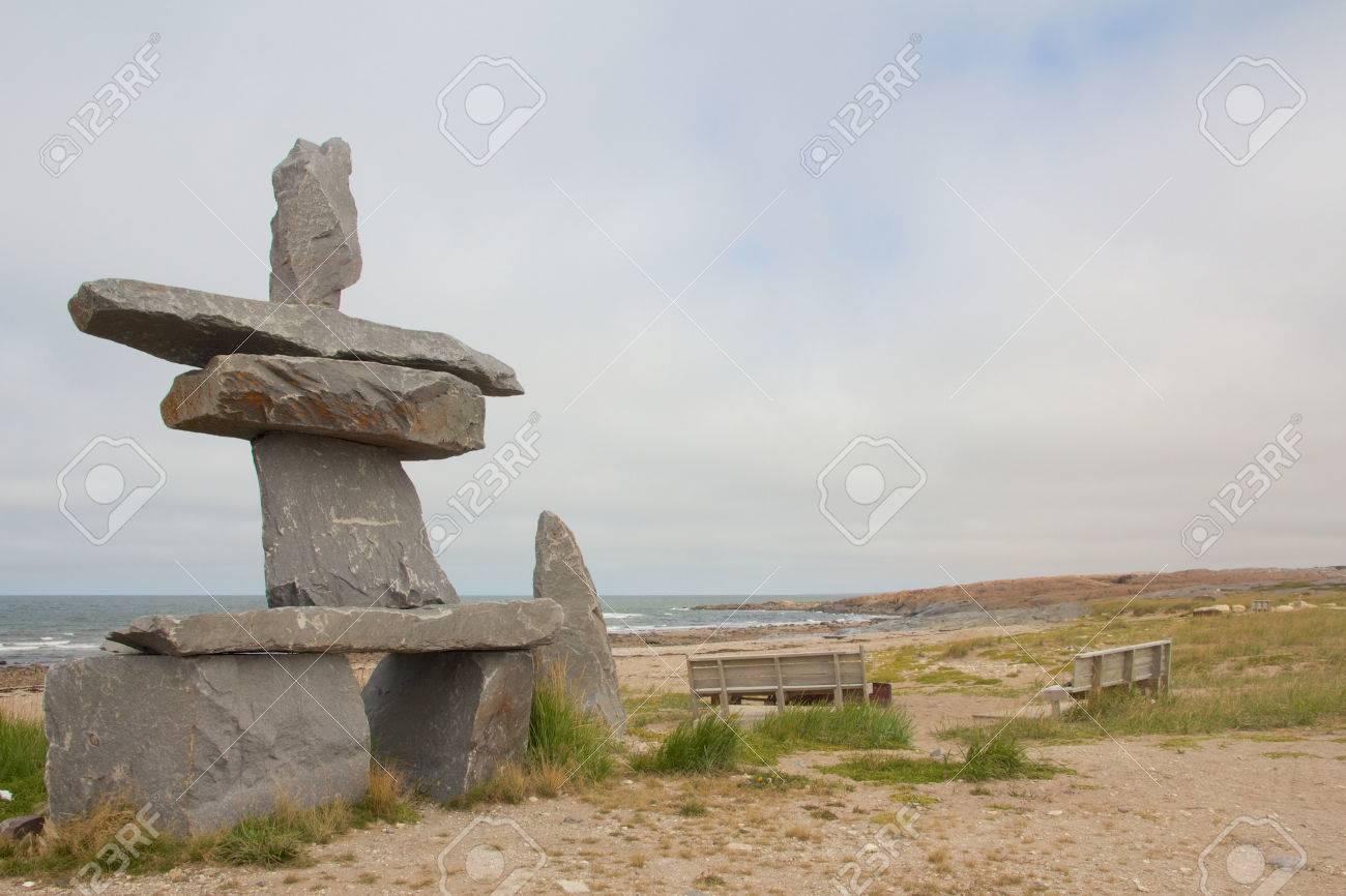 First Nations Inukshuk at the shores of Churchill, Manitoba, Canada - 23181423