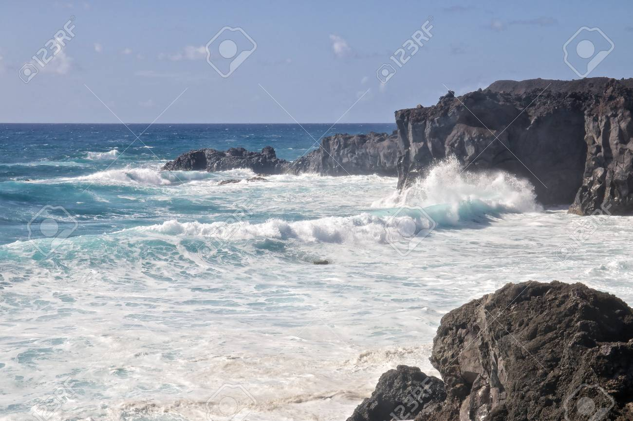 Wild sea and volcanic lava rocks at the Los Hervideros west coast of Lanzarote island, Spain Stock Photo - 28603756