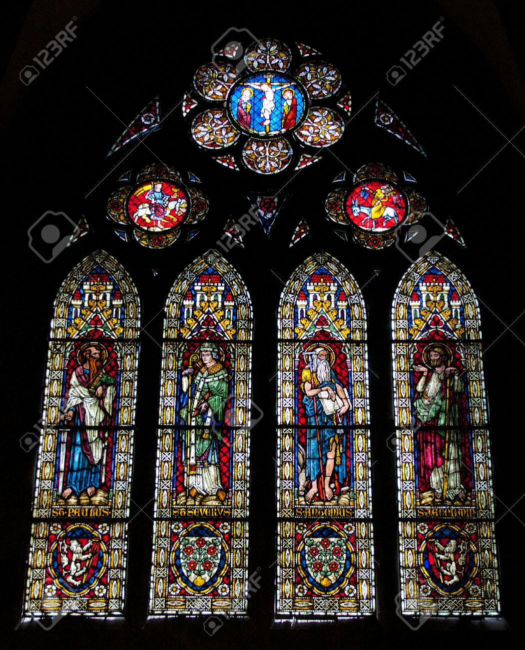 Beautiful Stained Glass Window In The Famous Gothic Cathedral Of Freiburg City Germany Stock Photo