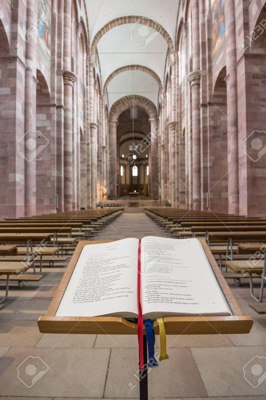 Impressions of the interior of famous Speyer Cathedral, Germany, a majestic building from the 13th century with a German Bible in the foreground - 37713199