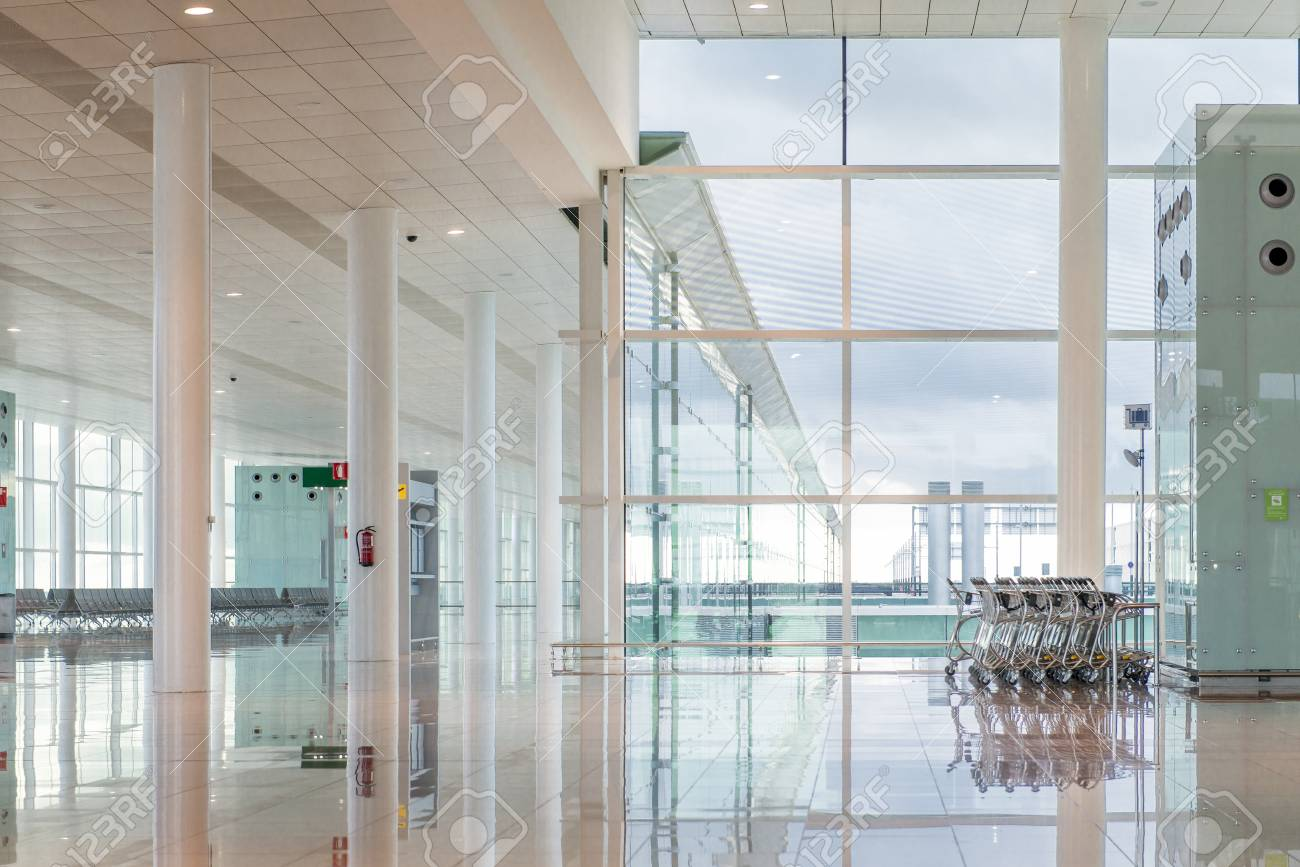 Modern interior of an airport terminal waiting area empty hall