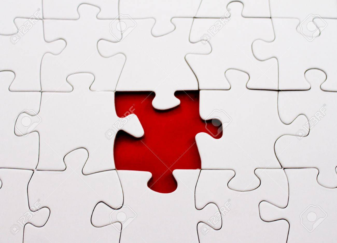 Blank Jigsaw Puzzle Missing Piece In Red Stock Photo