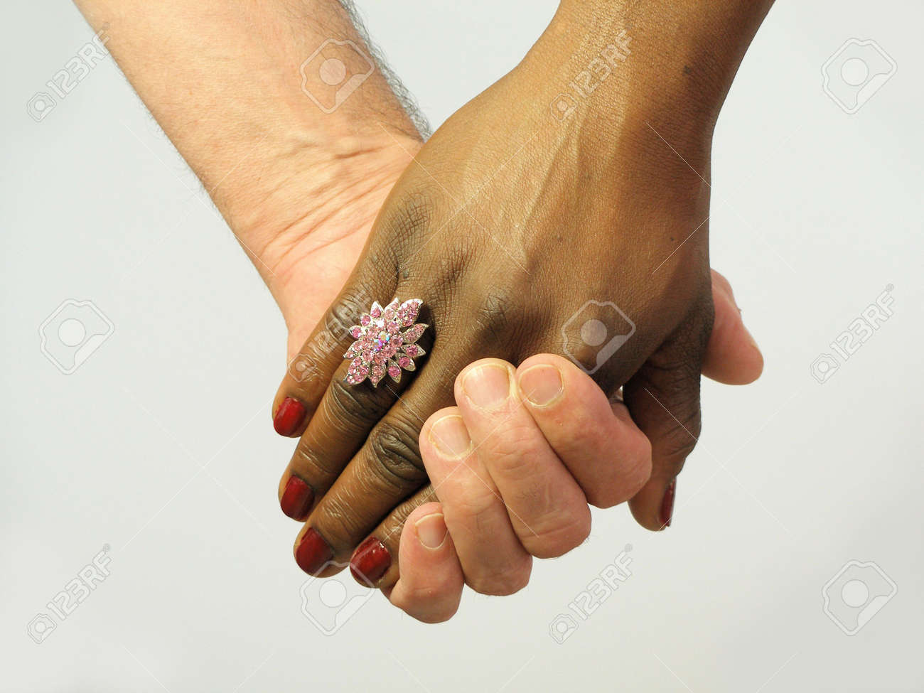 Black and white couples hands holding each others stock photo 500688