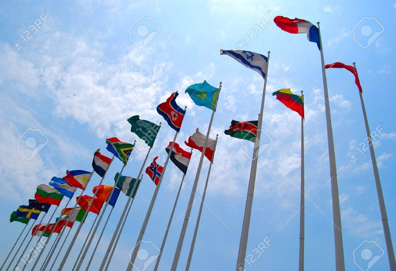 Group of flags against cloudy sky. Nobody. Stock Photo - 6932758