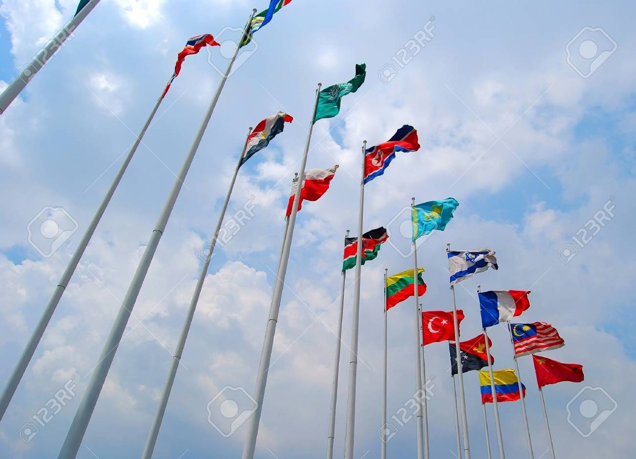 Group of Flags against cloudy sky. Stock Photo - 7319069