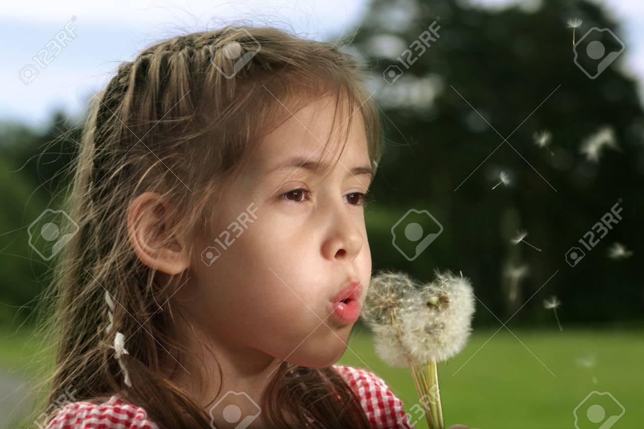 beauty girl blow on dandelion Stock Photo - 10378367