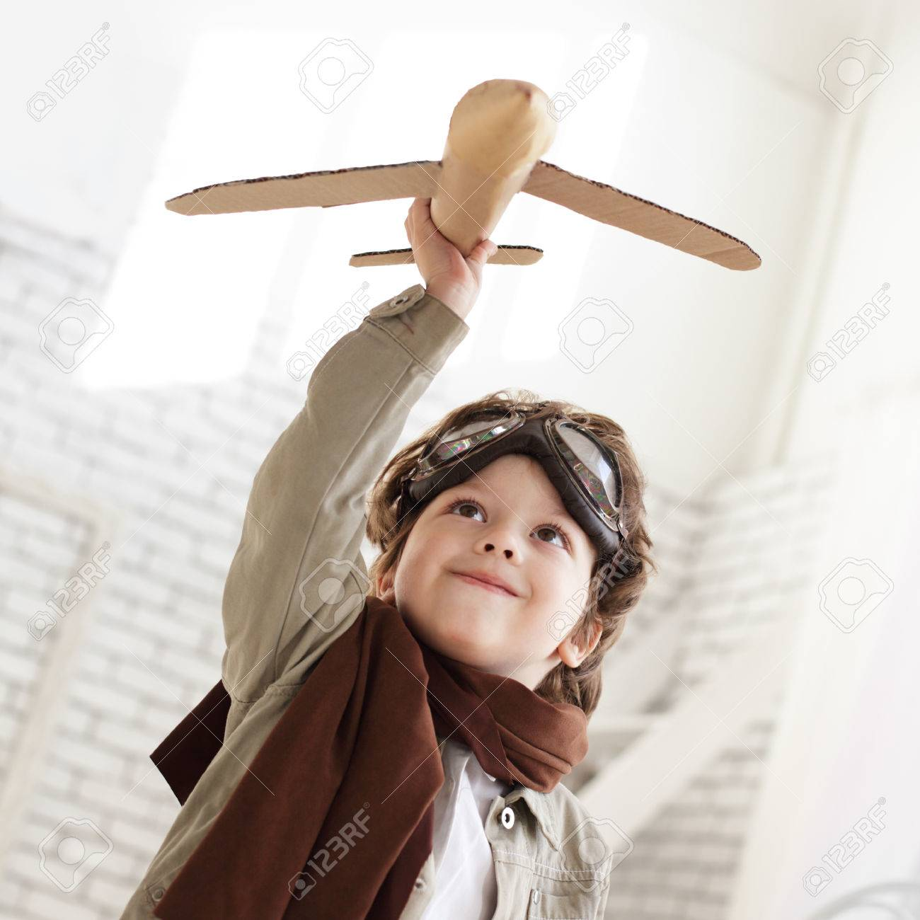 happy boy with airplane in hand - 26035359