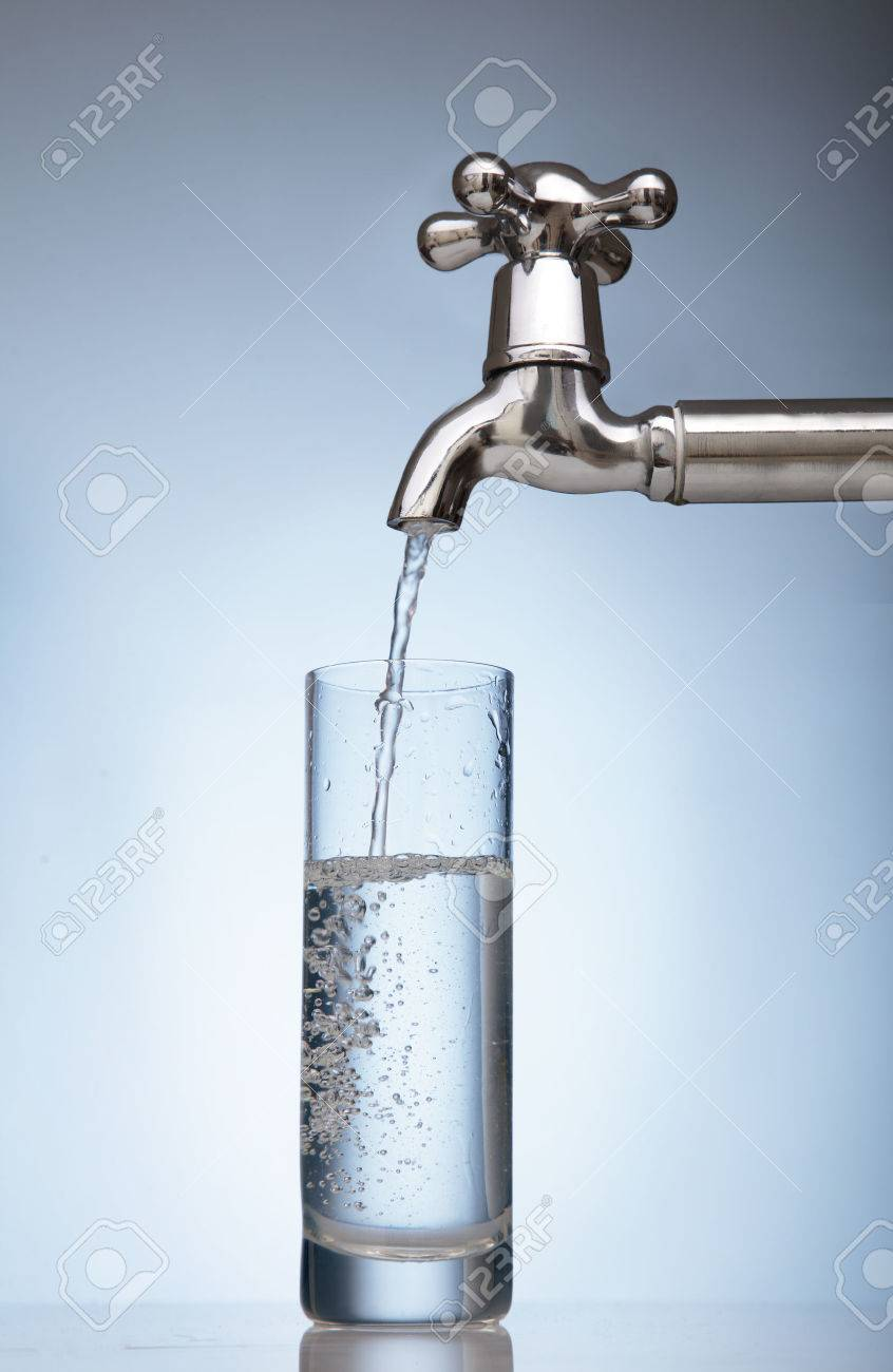 clean water is poured into a glass from the tap - 31960023