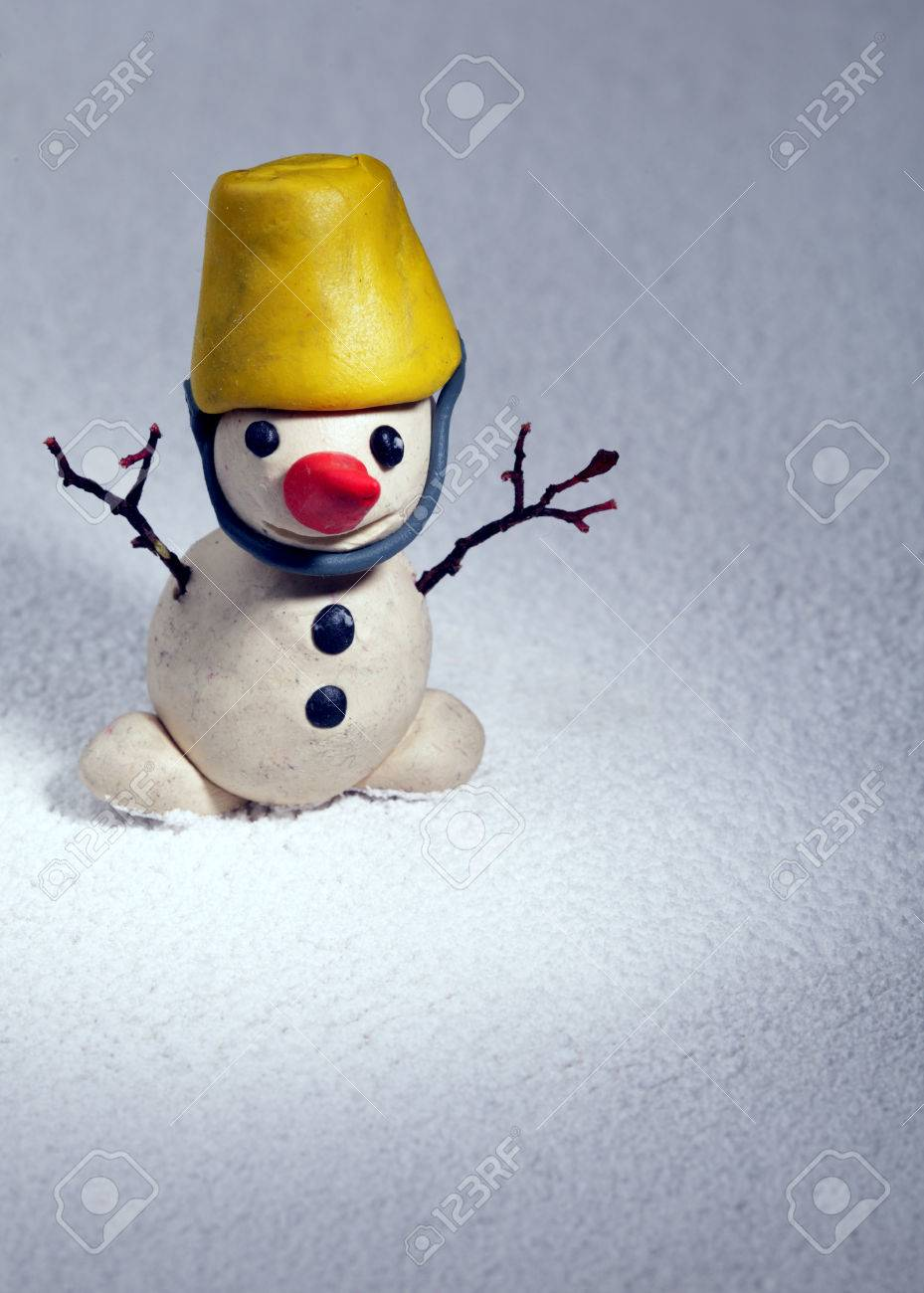 Little Snowman Made Of Plasticine Standing On Real Snow Christmas Gift Hack Stock Photo