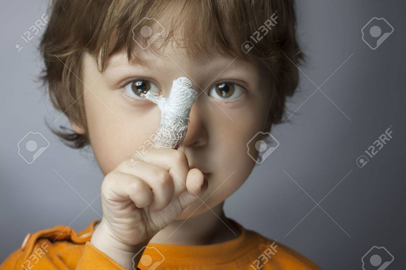 boy with a bandaged wound on his finger (focus on finger) - 43872694