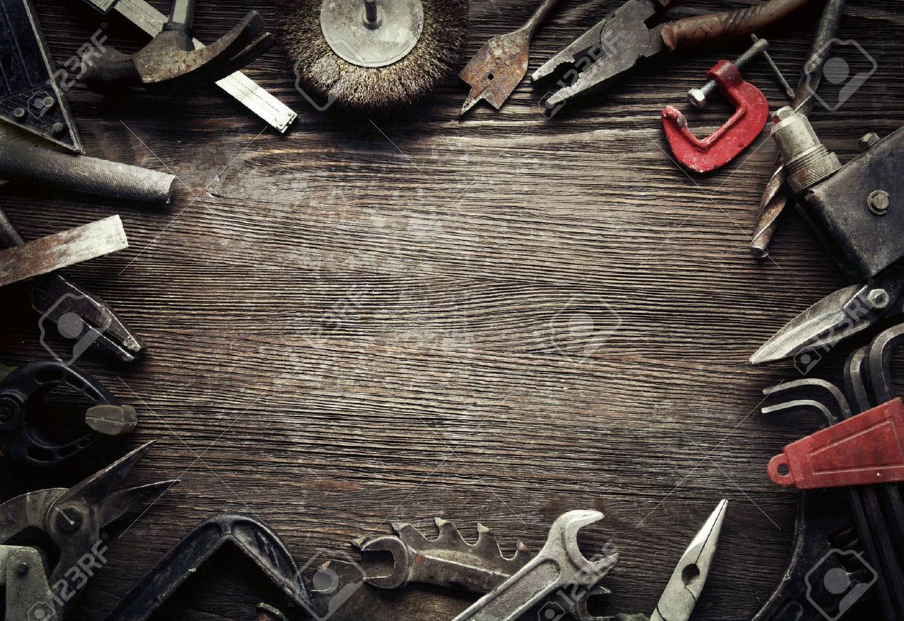 grungy old tools on a wooden background (processing cross-process) - 47627251