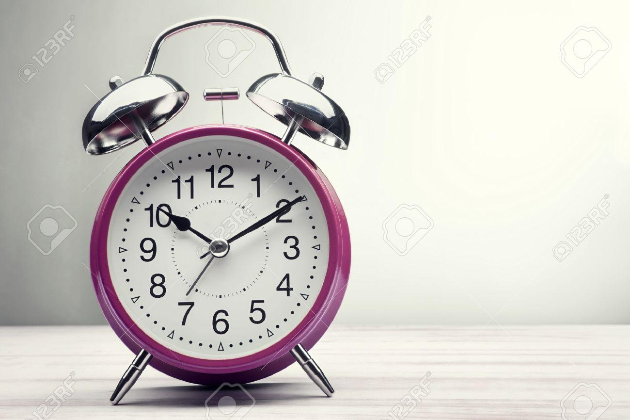 classic green alarm clock morning wake-up time - 55394820