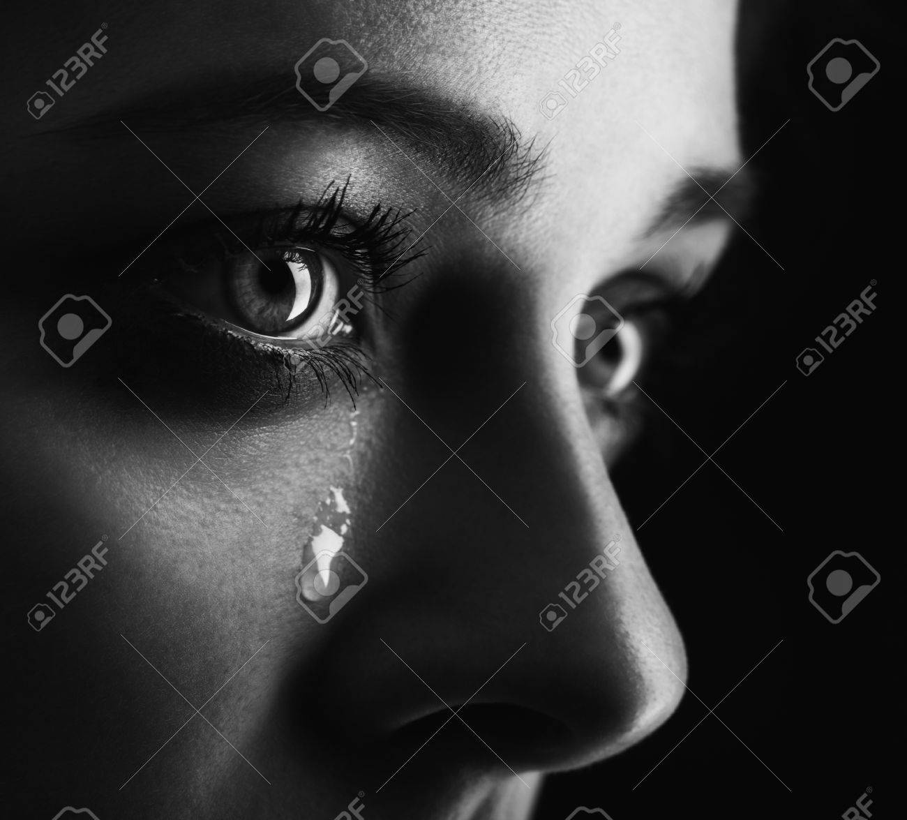beauty girl cry on black background (height contrast film monochrom edit) - 58843714