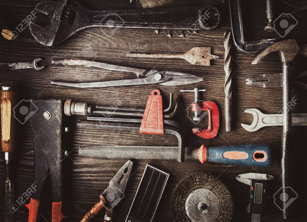 grungy old tools on a wooden background (processing cross-process) - 121579439