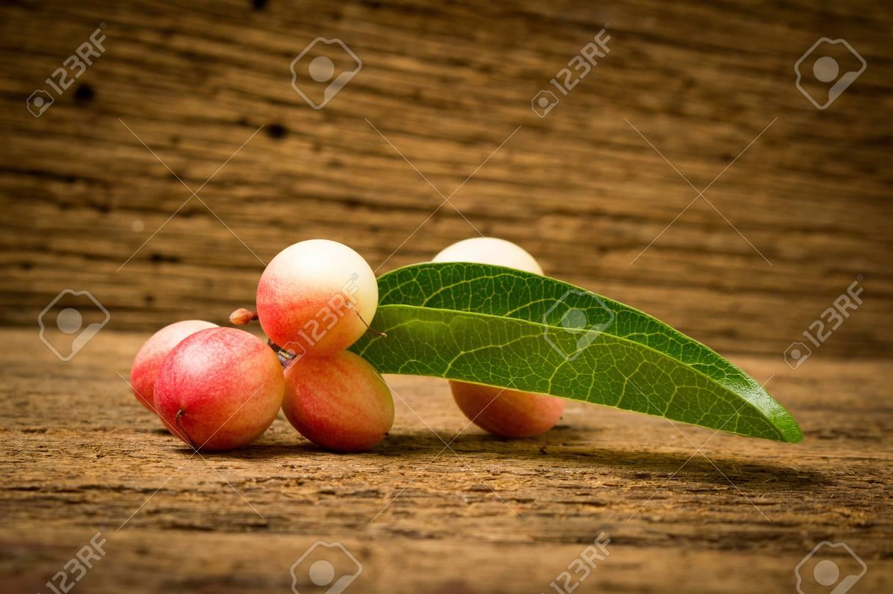 Karonda Fruit on old wood. - 110987138