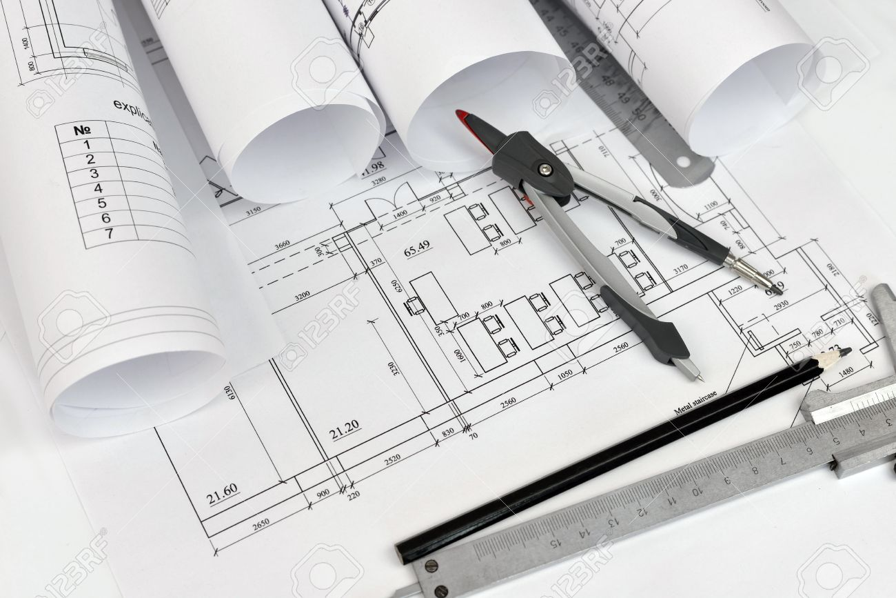Scrolls Of Architectural Drawings And Tools The Architect Desk Stock Photo
