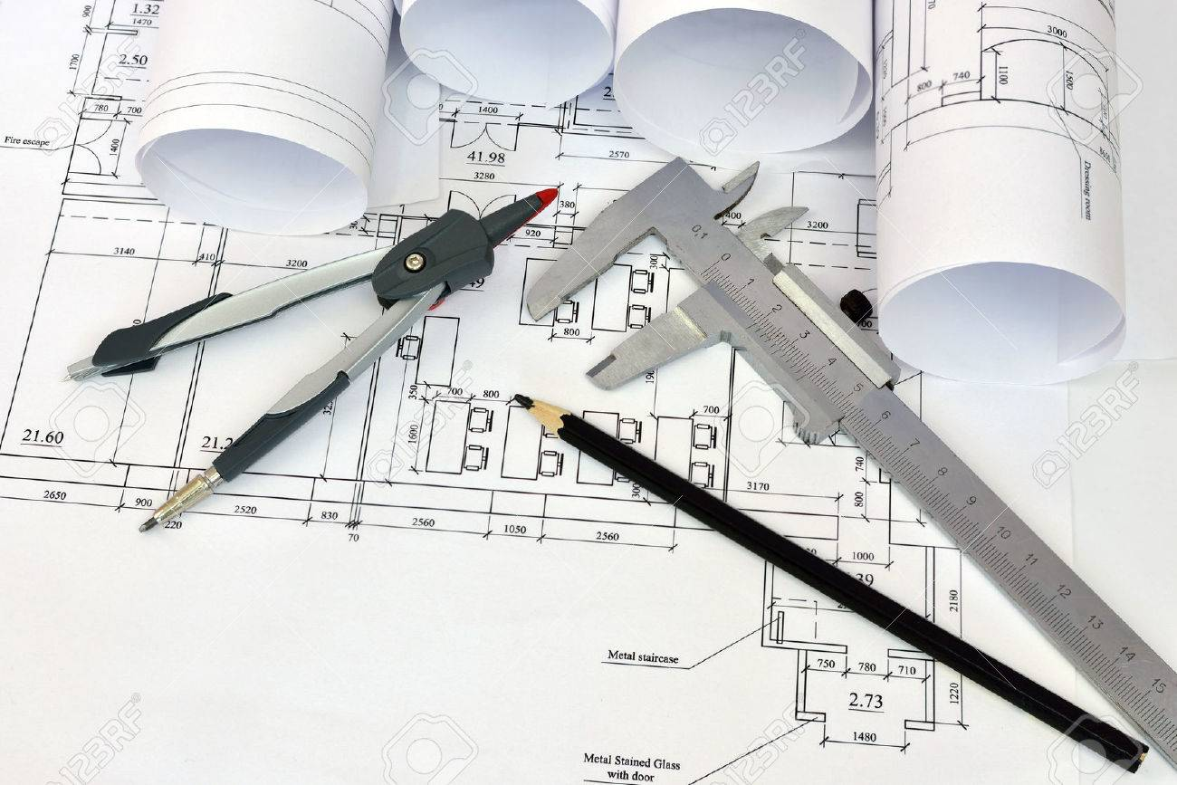Architect Desk scrolls architectural drawings and tools of the architect desk