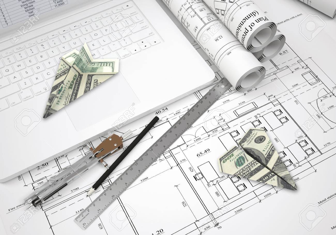 Paper Airplanes Of Dollars Lying On Laptop Keyboard And Architectural Drawings Tools Are Close By