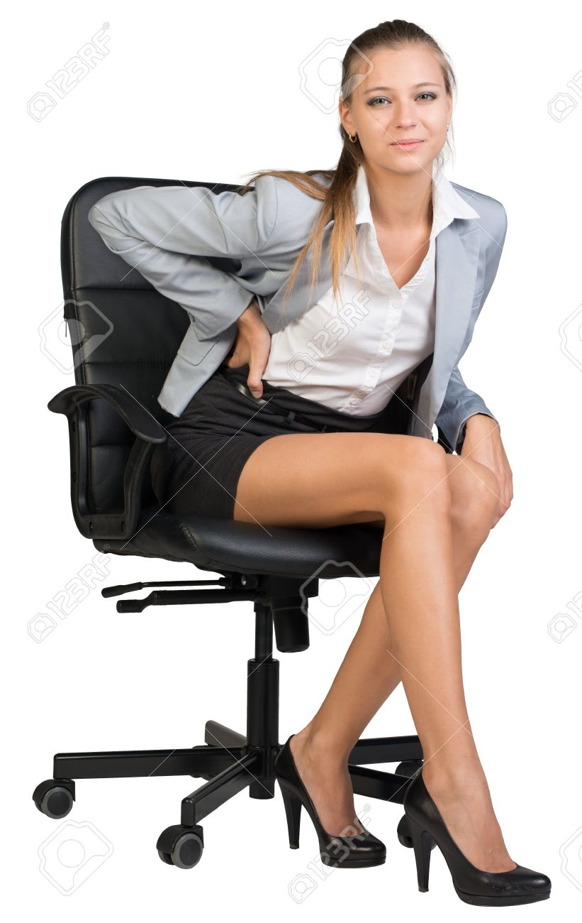 Businesswoman with lower back pain from sitting on office chair looking at camera. Isolated  sc 1 st  123RF.com & Businesswoman With Lower Back Pain From Sitting On Office Chair ...