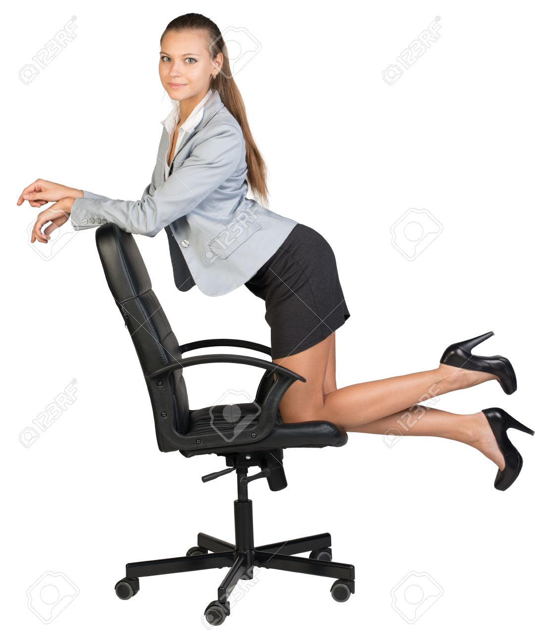 businesswoman kneeling on office chair her arms on chair back