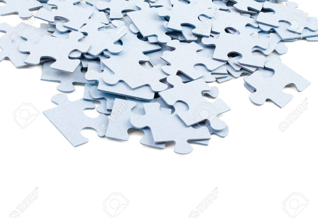 Pile Of Grey Blank Puzzle Pieces Isolated On White Background Stock Photo