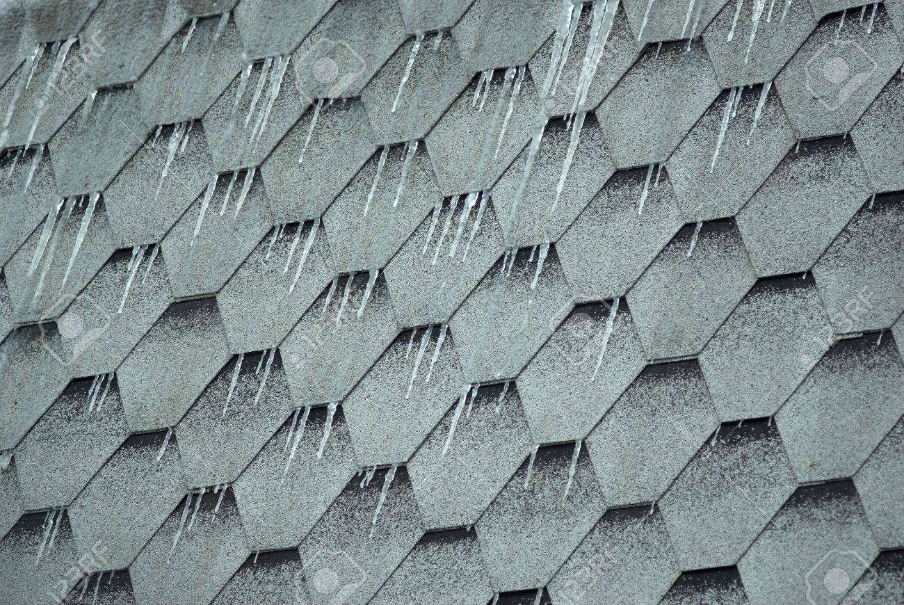 icicles on a roof from a hexagonal tile Stock Photo - 3276303