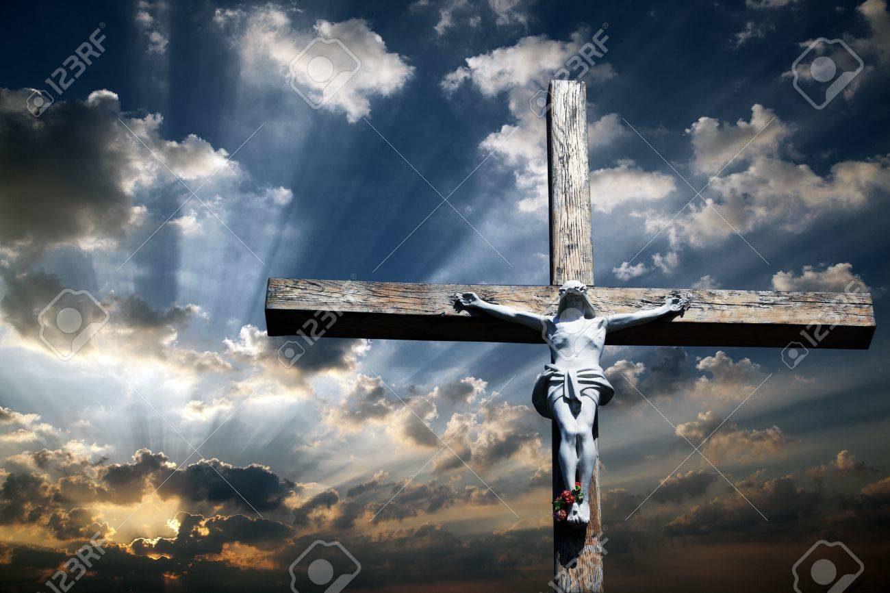 The Cross Of Jesus Christ Against The Beautiful Sky Stock Photo