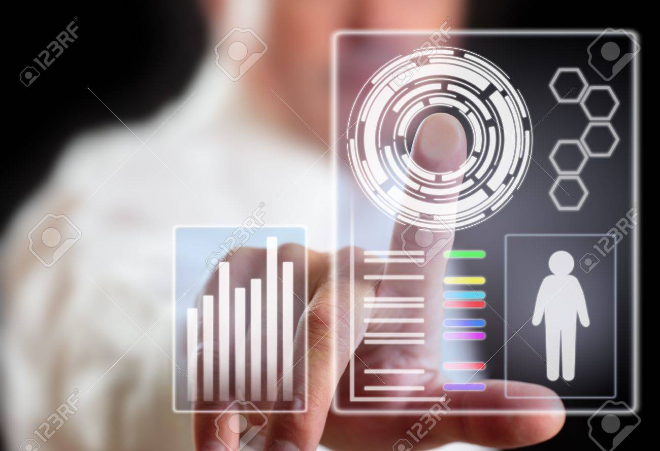 Man and computer display technology of future. Stock Photo - 16797276