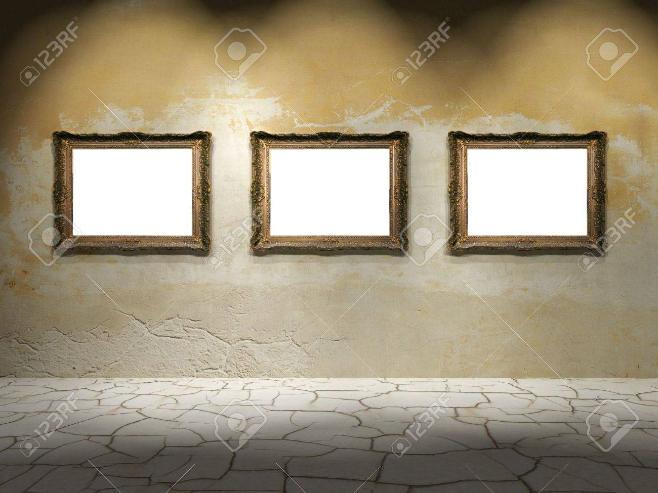 A dark room with gold frames on the wall Stock Photo - 5245383