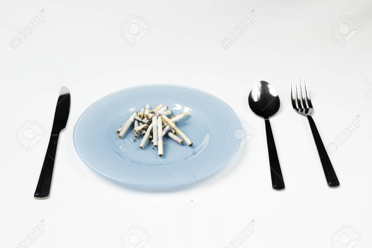 Blue Plate With Cigarette Butts And Cutlery. Stock Photo, Picture ...