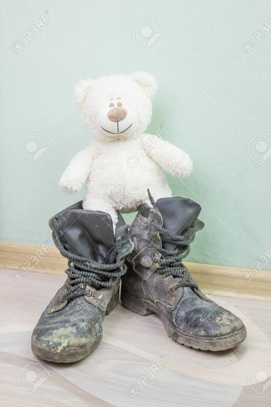 Toy And Old Army Boots. Stock Photo
