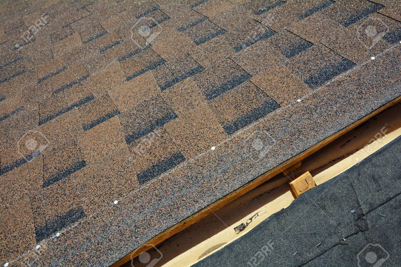 Installing Bitumen Roof Shingles. Roof Shingles   Roofing. Stock Photo    83809311