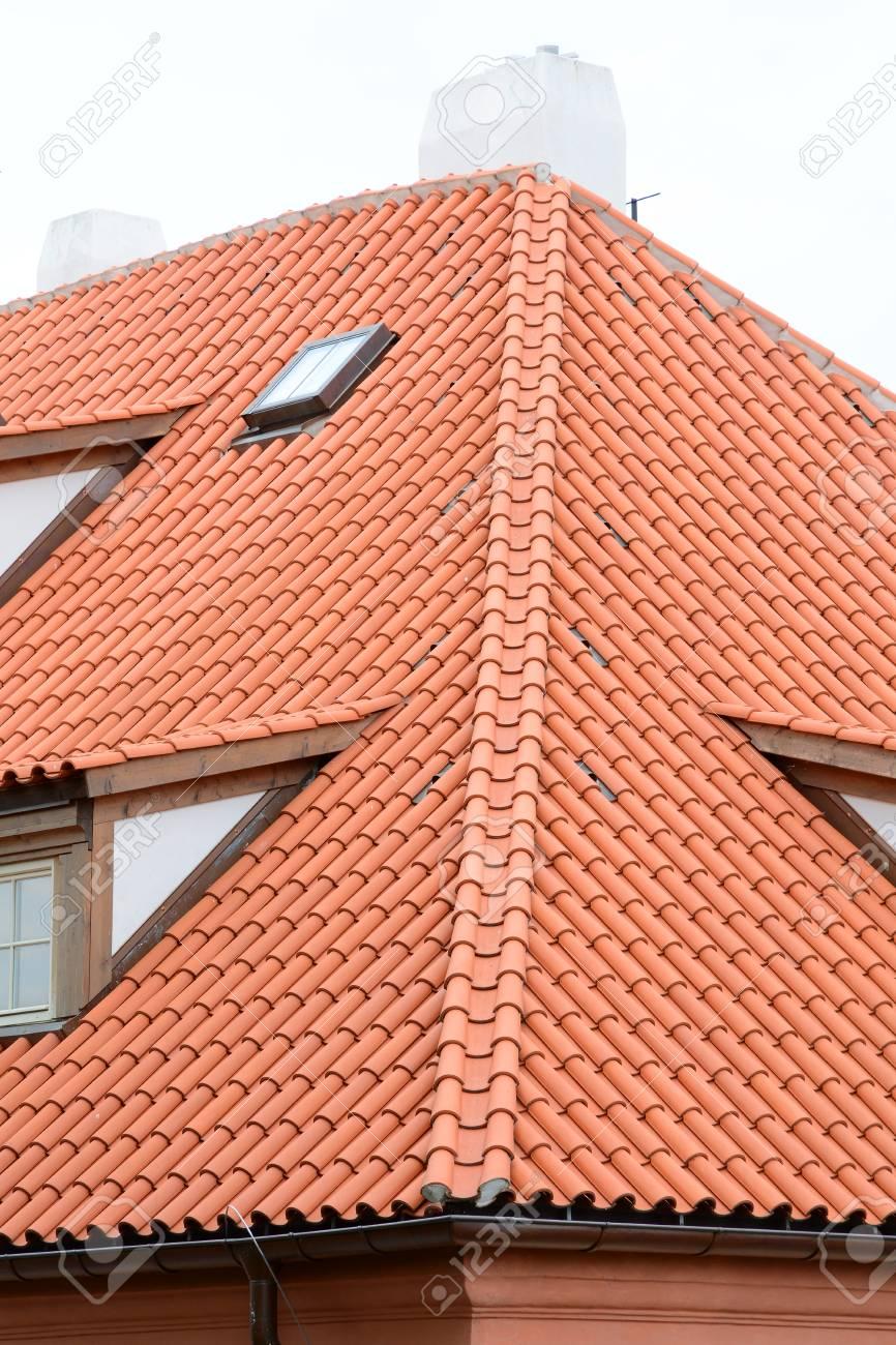 Red Ceramic Shingles Roof With Attic Windows. Ceramic Tiles Roof ...