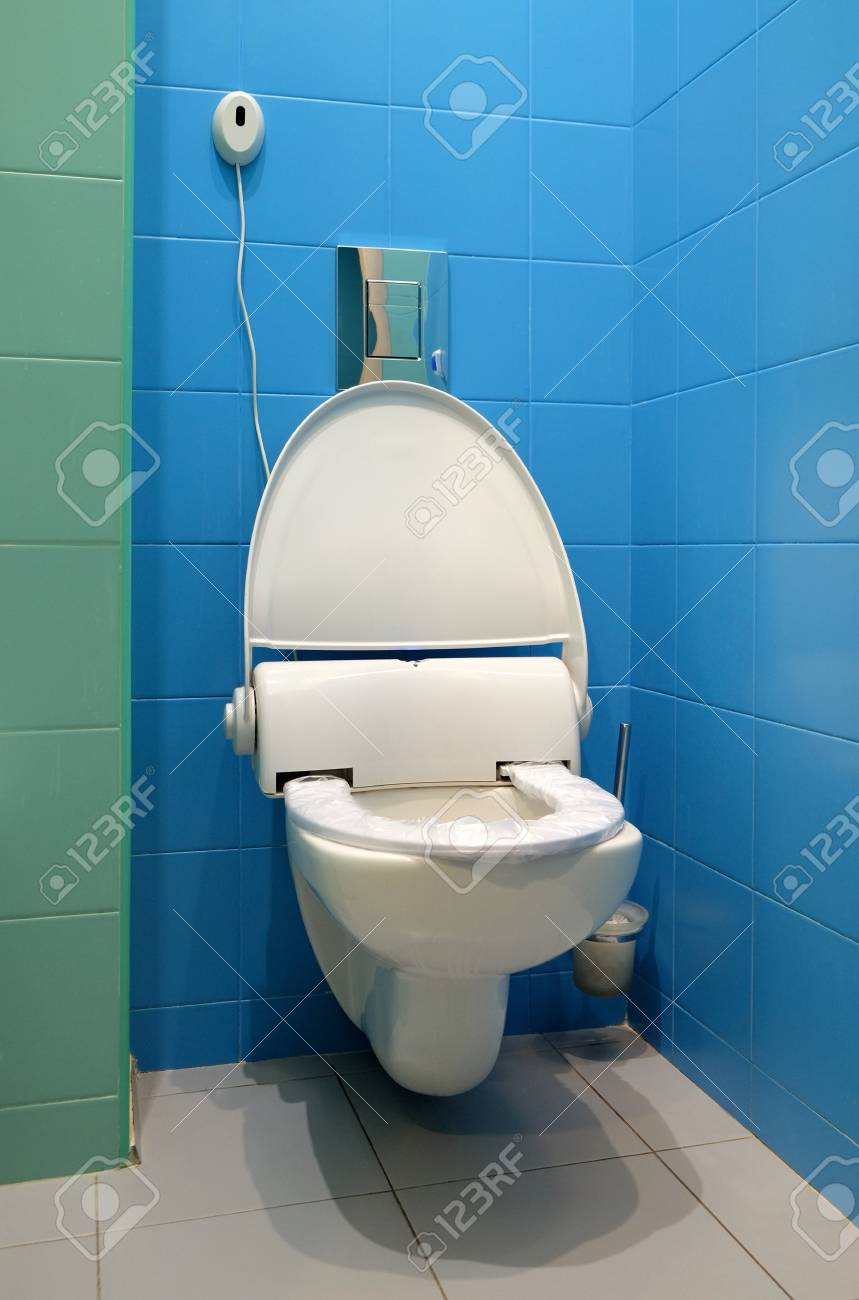 White High-tech Ceramic Toilet In Tiled Bathroom. Stock Photo ...